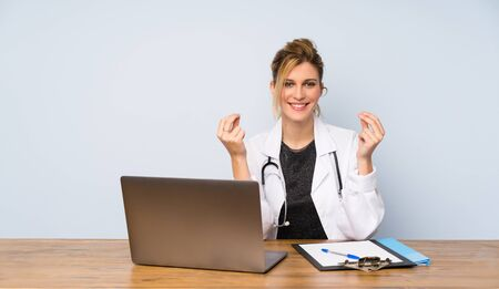 Blonde doctor woman making money gesture