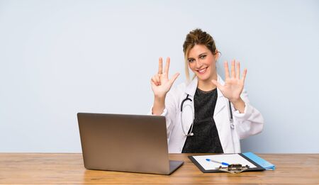 Blonde doctor woman counting eight with fingers