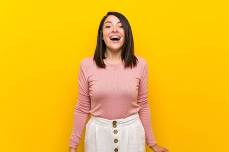 Young Mexican woman over isolated yellow background with surprise facial expression Stock fotó - 130156844