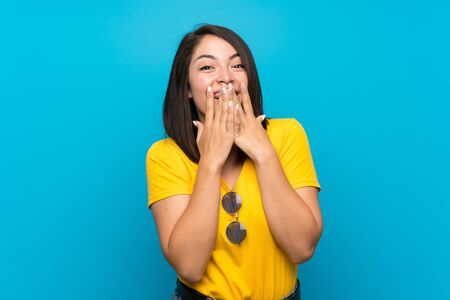 Young Mexican woman over isolated blue background with surprise facial expression Stock fotó - 130157540