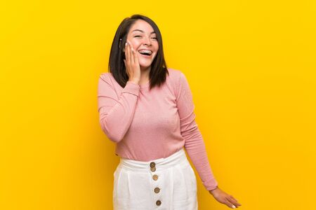Young Mexican woman over isolated yellow background with surprise and shocked facial expression Stock fotó - 130157946