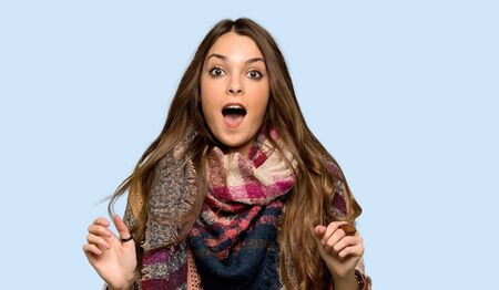 Young hippie woman with surprise and shocked facial expression over isolated blue background Stok Fotoğraf