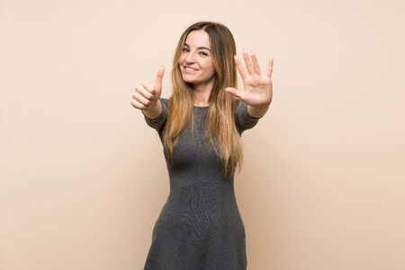 Young woman over isolated background counting six with fingers Stock fotó