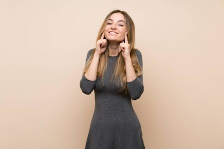 Young woman over isolated background smiling with a happy and pleasant expression