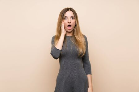 Young woman over isolated background with surprise and shocked facial expression