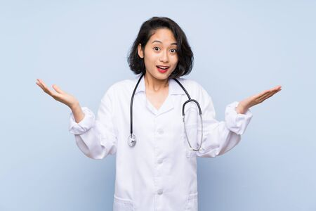 Doctor Asian woman with shocked facial expression