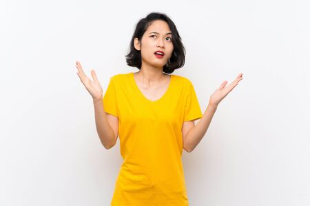 Asian young woman over isolated white background frustrated by a bad situation