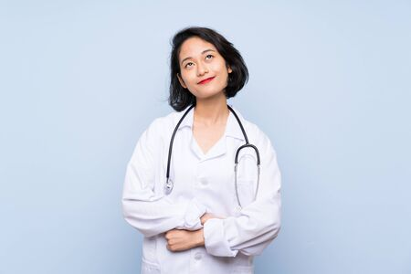 Doctor Asian woman looking up while smiling