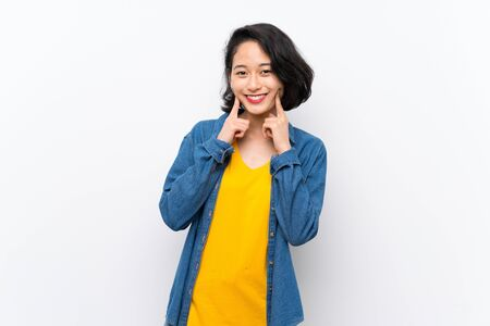 Asian young woman over isolated white background smiling with a happy and pleasant expression