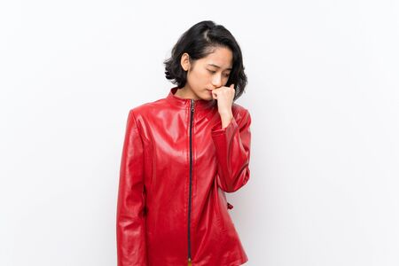 Asian young woman over isolated white background having doubts