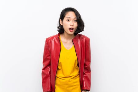 Asian young woman over isolated white background with surprise facial expression