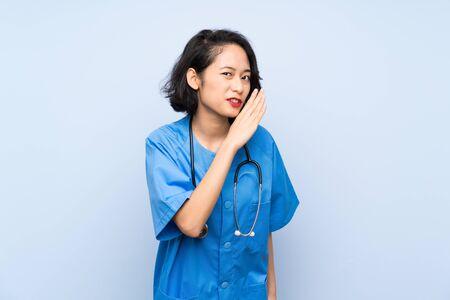 Surgeon doctor woman whispering something
