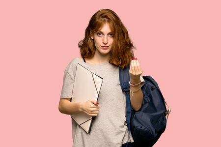 Young redhead student making Italian gesture over pink background 스톡 콘텐츠
