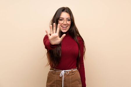 Teenager girl with glasses counting five with fingers