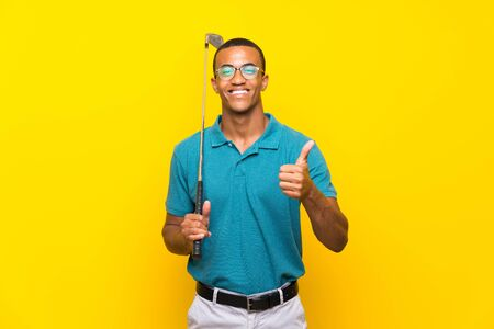 African American golfer player man with thumbs up because something good has happened