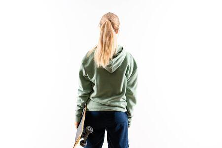 Blonde teenager skater girl over isolated white background 版權商用圖片 - 131777728