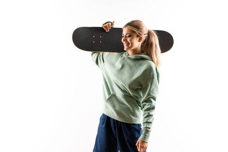 Blonde teenager skater girl over isolated white background