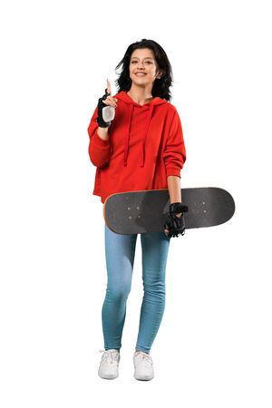 A full-length shot of a Young skater woman pointing up a great idea over isolated white background