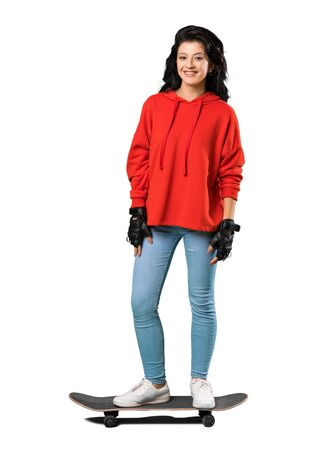A full-length shot of a Young skater woman with red sweatshirt over isolated white background 版權商用圖片 - 131778180