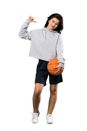 A full-length shot of a Young woman playing basketball proud and self-satisfied over isolated white background