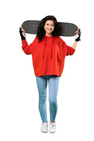 A full-length shot of a Young skater woman with red sweatshirt over isolated white background 版權商用圖片 - 131778204