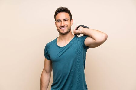 Handsome sport man over isolated background with kettlebell Stockfoto