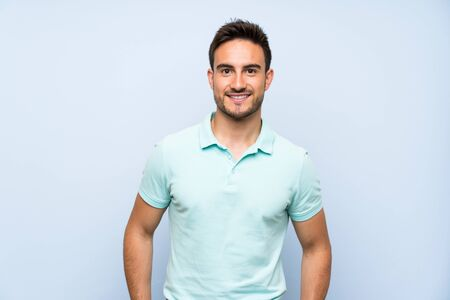Handsome young man over isolated background laughing