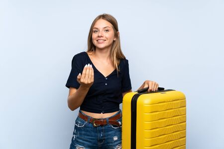 Traveler blonde woman with suitcase inviting to come with hand. Happy that you came