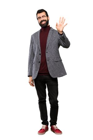 Handsome man with glasses saluting with hand with happy expression over isolated white background Stok Fotoğraf