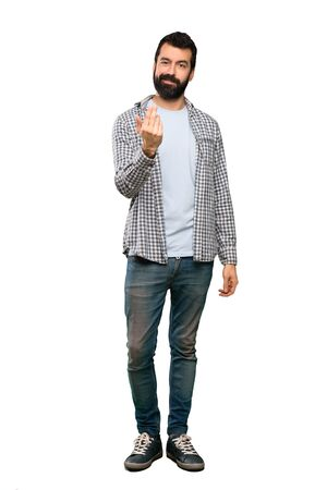 Handsome man with beard inviting to come with hand. Happy that you came over isolated white background