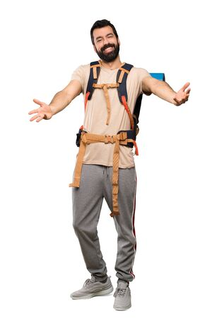 Hiker man presenting and inviting to come with hand over isolated white background