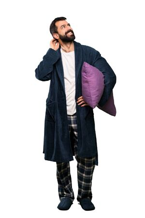 Man with beard in pajamas thinking an idea over isolated white background Zdjęcie Seryjne - 131714013