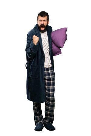 Man with beard in pajamas frustrated by a bad situation over isolated white background