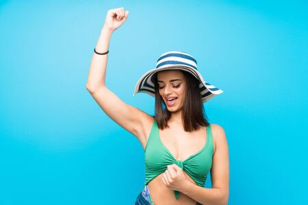 Young woman in swimsuit in summer holidays celebrating a victory Stok Fotoğraf - 132036304