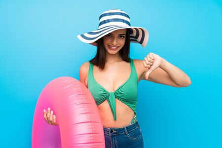 Young woman in swimsuit in summer holidays proud and self-satisfied
