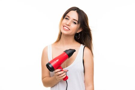 Young woman over isolated white background with hairdryer
