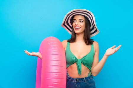 Young woman in swimsuit in summer holidays with surprise facial expression
