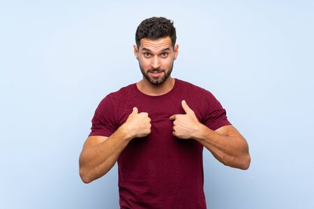 Handsome man over isolated blue background with surprise facial expression