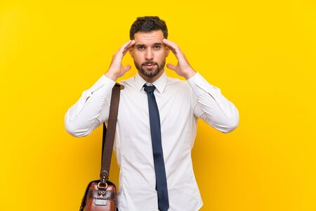 Handsome businessman over isolated yellow background unhappy and frustrated with something. Negative facial expression