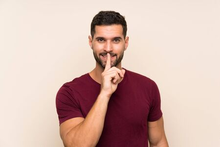 Handsome man over isolated background doing silence gesture Stock fotó