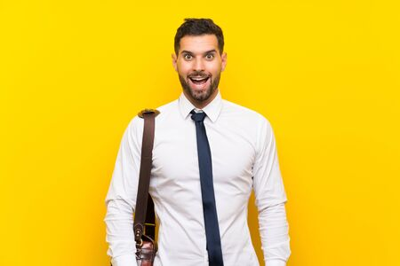 Handsome businessman over isolated yellow background with surprise facial expression Zdjęcie Seryjne