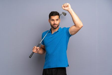Handsome young man playing golf celebrating a victory