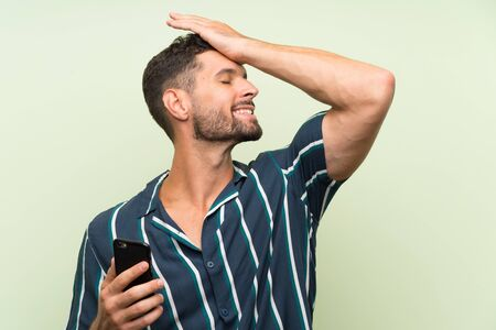Young handsome man with a mobile has realized something and intending the solution
