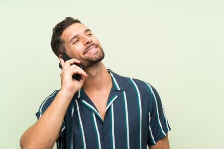 Young handsome man with a mobile
