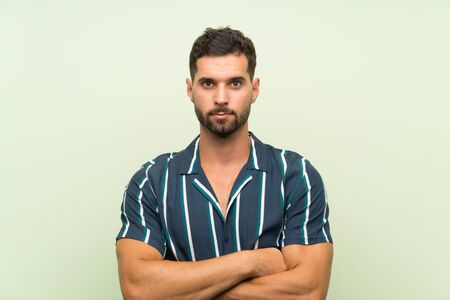 Handsome man over isolated background keeping arms crossed Stock fotó