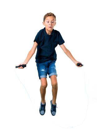 Little kid jumping rope on isolated white background
