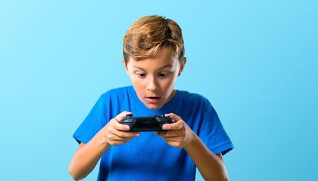Kid playing the console