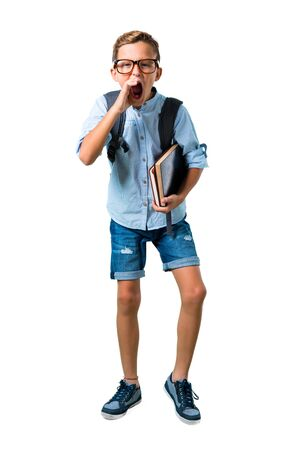Full body of Student boy with backpack and glasses shouting with mouth wide open on isolated white background