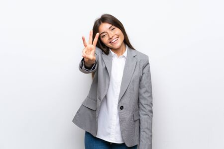 Young business woman over isolated white background happy and counting three with fingers