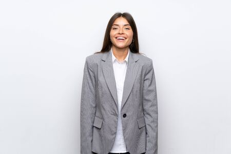 Young business woman over isolated white background laughing